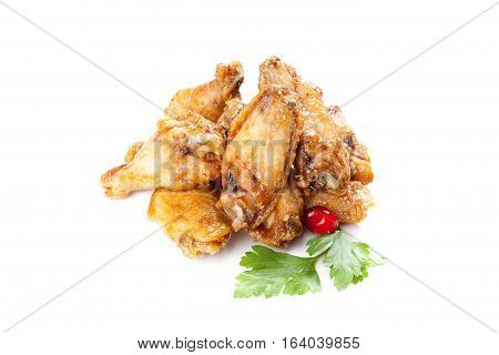 Roasted chicken drumsticks  isolated on white background.