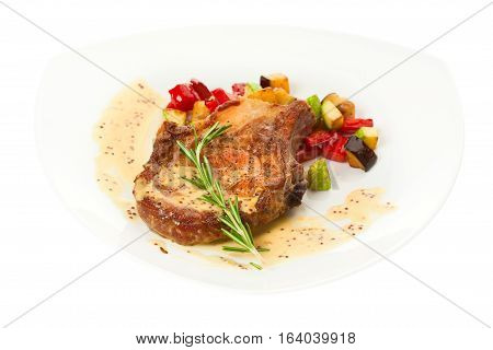 Grilled pork loin with vegetables on the plate
