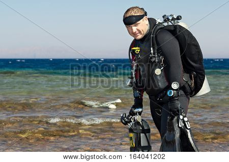 Technical Diver after dive. Looking  At Camera.