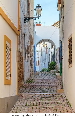 Old streets with pavement of the town Albufeira. Portugal