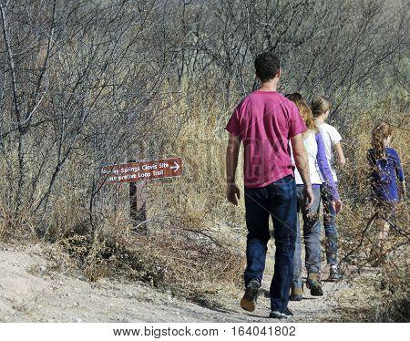 SIERRA VISTA, ARIZONA, DECEMBER 20. The Murray Springs Clovis Site on December 20, 2016, east of Sierra Vista, Arizona. A family hikes at the Murray Springs Clovis Paleoindian Site.