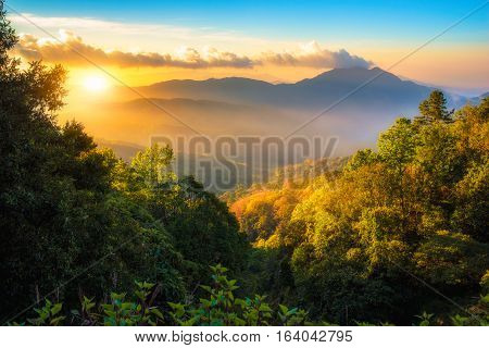 Mountains and mist at sunrise time Landscape view at Doi Inthanon National Park High mountain in Chiang Mai Province Thailand
