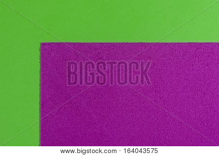 Eva foam ethylene vinyl acetate sponge plush pink surface on apple green smooth background