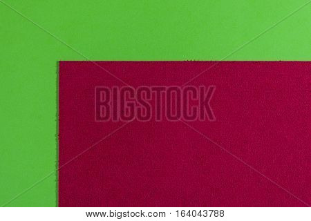 Eva foam ethylene vinyl acetate sponge plush red surface on apple green smooth background