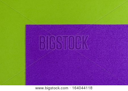 Eva foam ethylene vinyl acetate sponge plush purple surface on apple green smooth background