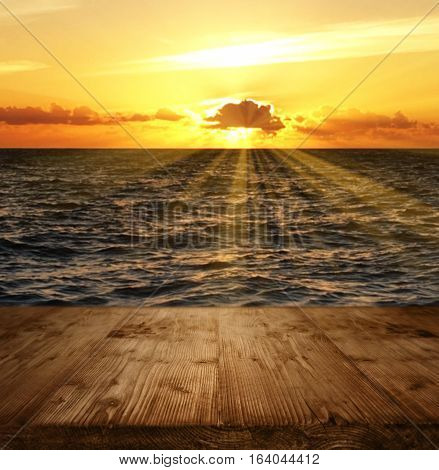 Fantastic sunset at the sea in front of a boat bridge