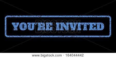 Blue rubber seal stamp with You'Re Invited text. Vector caption inside rounded rectangular banner. Grunge design and scratched texture for watermark labels. Horisontal sign on a black background.