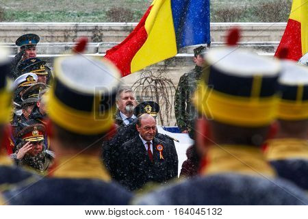 BUCHAREST ROMANIA - DECEMBER 1 2014: Romanian president Traian Basescu is taking part to a military parade on National Day of Romania. More than 3000 soldiers and personnel from security agencies take part in the massive parades on National Day of Romania