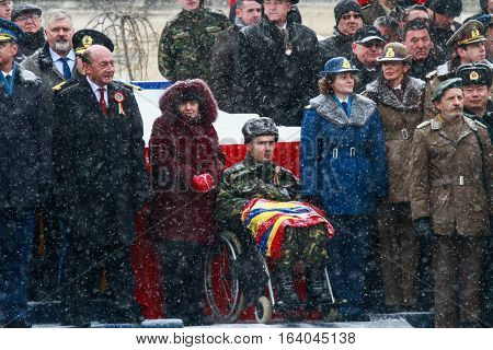 BUCHAREST ROMANIA - DECEMBER 1 2014: A war veteran is taking part next to the Romanian president and other officials to a military parade on National Day of Romania. More than 3000 soldiers and personnel from security agencies take part in the massive par