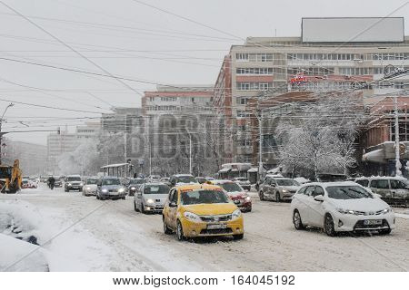 BUCHAREST ROMANIA JANUARY 17 2016: Vehicles are seen in traffic at a rush hour during a snowfall in Bucharest.