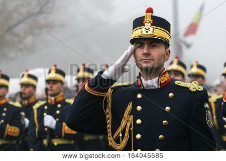 BUCHAREST ROMANIA - DECEMBER 1 2008: A military from the National Guard salutes during a military parade. More than 3000 soldiers and personnel from security agencies take part in the massive parades on National Day of Romania.