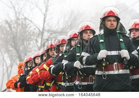 BUCHAREST ROMANIA - DECEMBER 1 2008: Soldiers from the fire department are marching during a military parade in Bucharest. More than 3000 soldiers and personnel from security agencies take part in the massive parades on National Day of Romania.