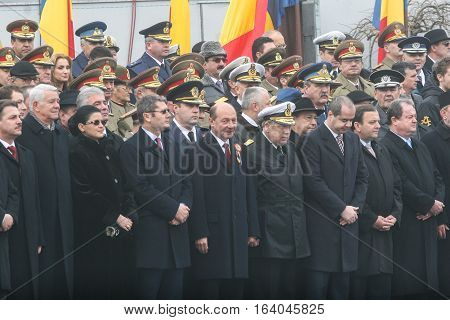 BUCHAREST ROMANIA - DECEMBER 1 2009: Romanian president Traian Basescu and other officials are taking part to a military parade on National Day of Romania. More than 3000 soldiers and personnel from security agencies take part in the massive parades on Na