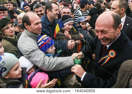 BUCHAREST ROMANIA - DECEMBER 1 2009: Romanian president Traian Basescu is taking part to a military parade on National Day of Romania. More than 3000 soldiers and personnel from security agencies take part in the massive parades on National Day of Romania