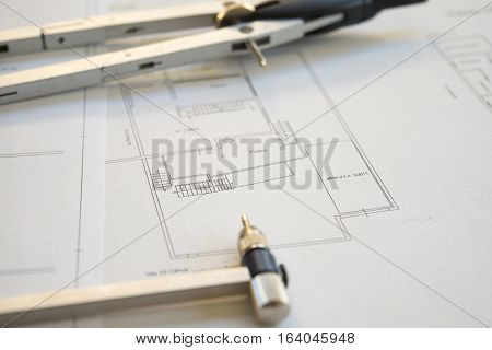 engeneer building project with map and compass