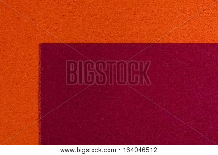 Eva foam ethylene vinyl acetate red surface on orange sponge plush background