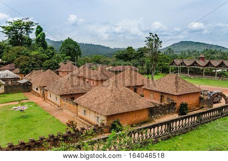 Traditional and historical palace of the Fon of Bafut with brick and tile buildings and jungle environment, Cameroon, Africa