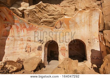 KAKHETI, GEORGIA - OCT 8, 2016: Medieval caves with ancient frescoes of the 6th century David Gareji monastery with arches and ruined churches on October 8, 2016. UNESCO world heritage site