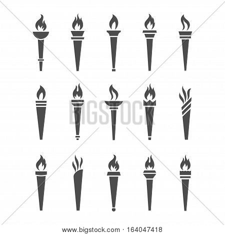 Icons torch with flame isolated vector set. The symbol of victory success or achievement. Silhouettes of various medieval flaming torches.