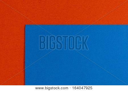 Eva foam ethylene vinyl acetate blue surface on orange sponge plush background