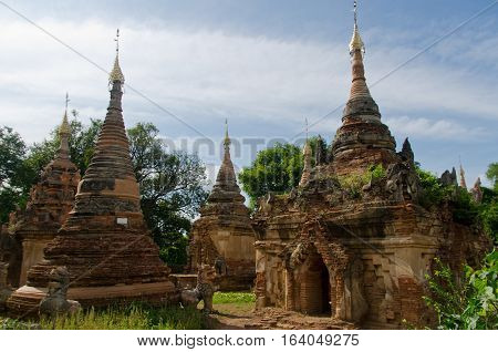 Remains of ancient brick towers at Inwa outside of Mandalay