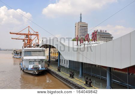 NANJING, CHINA - JUL. 22, 2012: Zhongshan Wharf is the largest port along Yangtze River built in 1936 in Nanjing, Jiangsu Province, China.