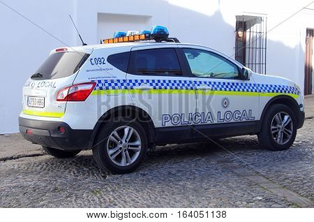 Ronda, Spain - Januari 2, 2017: Spanish local police car, Nissan Qashqai, parked by the side of the road in the city of Rondas. Nobody in the vehicle.