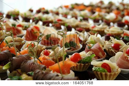 Savoury Canapes with Ham and Red Fish Closeup Ctock Photo