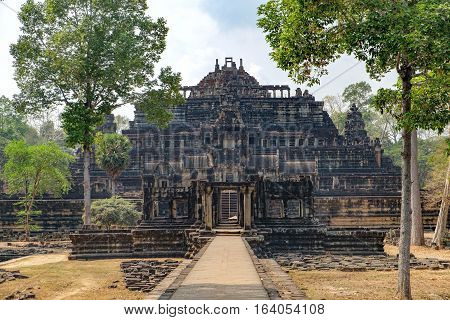 Baphuon Temple in Angkor Complex Siem Reap Cambodia. It is three-tiered temple mountain and dedicated to the Hindu God Shiva. Ancient Khmer architecture and famous Cambodian landmark, World Heritage