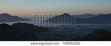 View from a place near Begnas Tal. Town Lekhnath and hills at dawn.