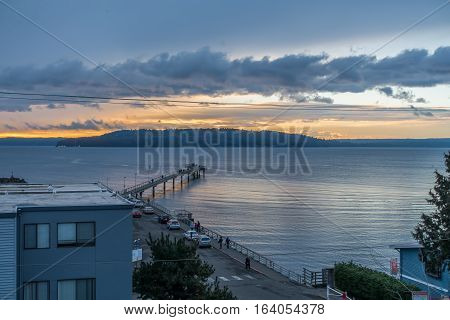 The pier in Des Moines Washington points toward the sunset.