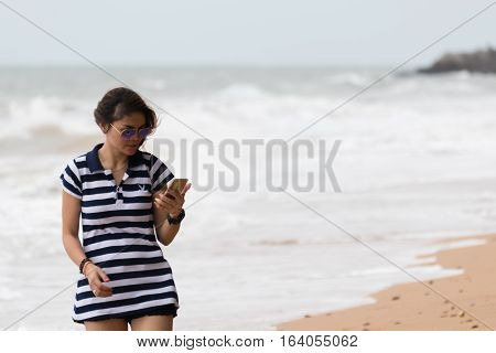 Asia Woman Walking At Beach With Blue Sea And Sky