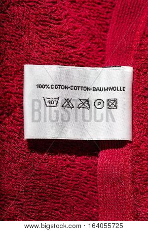 Clothing label with laundry care instructions closeup