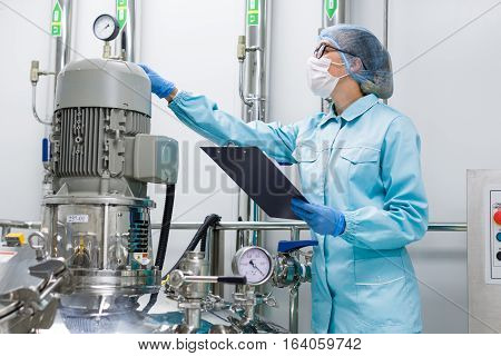 Scientist Monitors The Readings On The Equipment