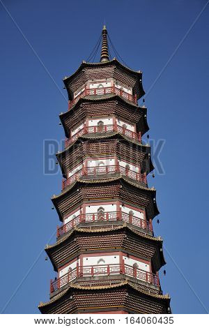 Chigang Pagoda or tower in the city of Guangzhou china in Guangdong province against a blue sky.