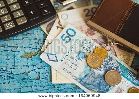 Polish Zloty With A Wallet And Calculator, Wooden Background