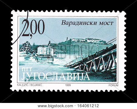 YUGOSLAVIA - CIRCA 1999 : Cancelled postage stamp printed by Yugoslavia, that shows Bombarding of Varadinski bridge.