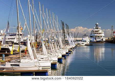 Sailing yachts and private boats moored at pier in Sochi seaport. Grand Marina station complex Port. Krasnodarskiy kray Russia