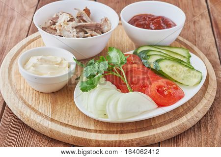 Prepared foods for doner kebab with tomatoes meat and greens.