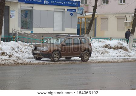 SARANSK, RUSSIA - JANUARY 1, 2017: Brown Renault Duster in the town street.