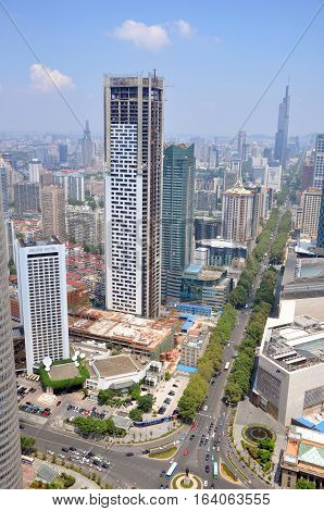 NANJING, CHINA - AUG. 6, 2012: Aerial view of Nanjing City center skyline (North) with unfinished Jinling Hotel on the left and Zifeng Tower far away, Nanjing, Jiangsu Province, China.