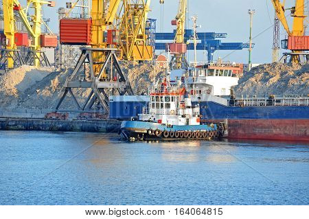 Tugboat Assisting Bulk Cargo Ship
