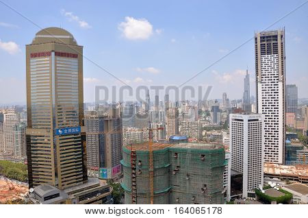 NANJING, CHINA - AUG. 6, 2012: Aerial view of Nanjing City center skyline (Northwest) with Jinying (Golden Eagle) shopping mall on the left and Jinling Hotel on the right, Nanjing, Jiangsu, China.