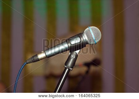 Vocal concert microphone on tripod side view closeup