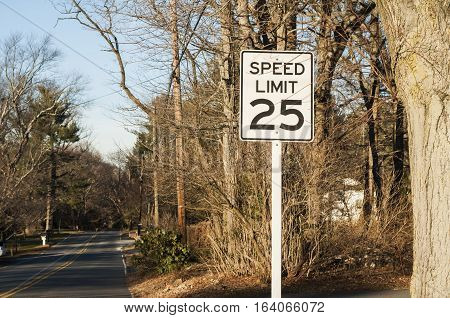White rectangular road sign about 25 miles speed limit