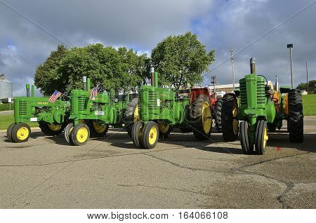 YANKTON, SOUTH DAKOTA, August 19, 2106: A series of restored vintage john Deere tractors are displayed at the annual Riverboat Days celebrated the third weekend of August