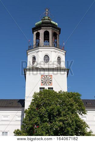 The Neue Residenz Clock Tower in Salzburg . Austria