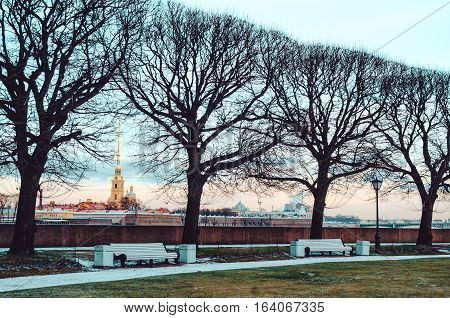 SAINT-PETERSBURG, RUSSIA - december 2015: Winter view on famous historical Peter and Paul Fortress and Neva River on sunset. Panorama of St Petersburg, Russia city with beautiful gold sky background.
