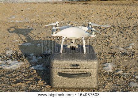 Rostov - on - Don, Russia - January 04, 2017: Flying drone quadcopter Dji Phantom 4 with high resolution digital camera.