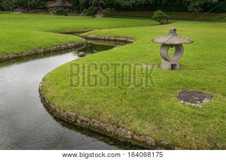 Stone Lantern In Korakuen Garden In Okayama, Japan